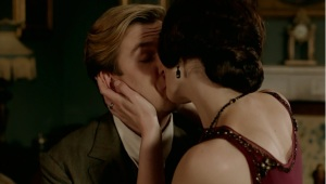 Strategic placement of Mary's hand as they kiss