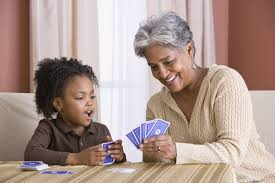 Nice grandma plays Go Fish with a smile. I don't think I'll be permitted to play cards with my grandchildren. Ever.